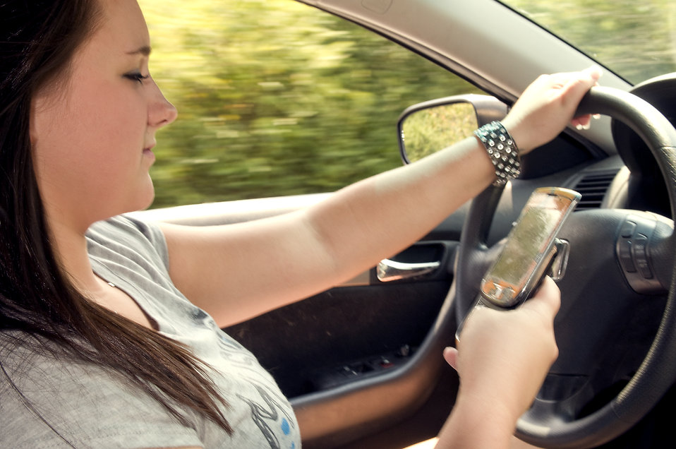 A Teen texting and driving