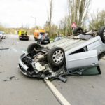 a car wreck photo with a car upside down