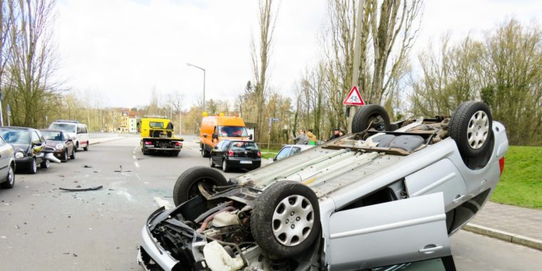 a Car Wrecked upside down.